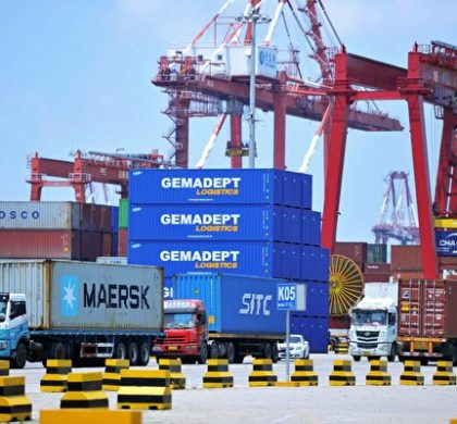 "Containers are transferred at a port in Qingdao in China's eastern Shandong province on July 6, 2018. - Punishing US tariffs on Chinese imports took effect on July 6, the first shot in what Beijing called ""the largest trade war in economic history"" between the world's top two economies. (Photo by - / AFP) / China OUT        (Photo credit should read -/AFP/Getty Images)"