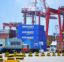 """Containers are transferred at a port in Qingdao in China's eastern Shandong province on July 6, 2018. - Punishing US tariffs on Chinese imports took effect on July 6, the first shot in what Beijing called """"the largest trade war in economic history"""" between the world's top two economies. (Photo by - / AFP) / China OUT        (Photo credit should read -/AFP/Getty Images)"""