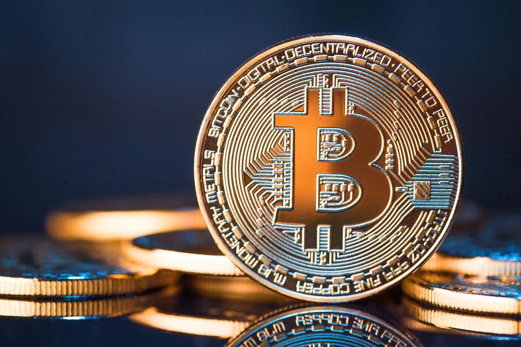 Golden Bitcoins on a blue background. New virtual money