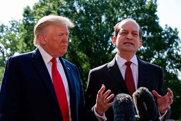 """US President Donald Trump (L) listens to US Labor Secretary Alexander Acosta as he speaks to the media early July 12, 2019 at the White House in Washington, DC. - Alex Acosta announced his resignation as US labor secretary Friday, amid criticism of a secret plea deal he negotiated a decade ago with Jeffrey Epstein, the financier accused of sexually abusing young girls. """"I called the president this morning and told him that I thought the right thing was to step aside,"""" Acosta said in a joint appearance with President Donald Trump at the White House. (Photo by Alastair Pike / AFP)        (Photo credit should read ALASTAIR PIKE/AFP/Getty Images)"""