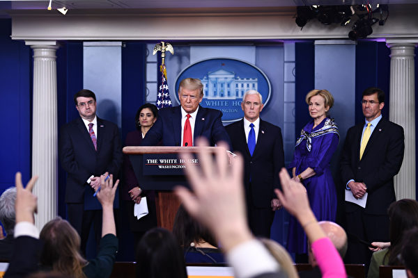US President Donald Trump takes a question during the daily briefing on the novel coronavirus, COVID-19, at the White House on March 18, 2020, in Washington, DC. - Trump ordered the suspension of evictions and mortgage foreclosures for six weeks as part of the government effort to ease the economic pain from the coronavirus pandemic. (Photo by Brendan Smialowski / AFP)