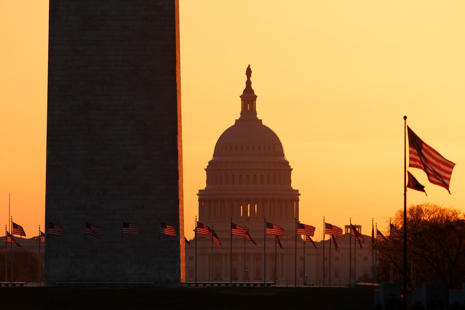 The Washington Monument and the U.S. Capitol are seen in Washington, at sunrise Wednesday, March 18, 2020. The White House has sent Congress an emergency $46 billion spending request for coronavirus-related funding this year. (AP Photo/Carolyn Kaster)
