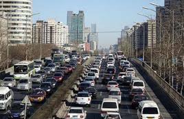 中国推动有关地方放宽或取消汽车限购措施