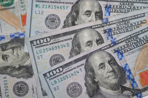 The likeness of Benjamin Franklin shown from $100 bills in Dallas, Wednesday, Jan. 22, 2020. (AP Photo/LM Otero)