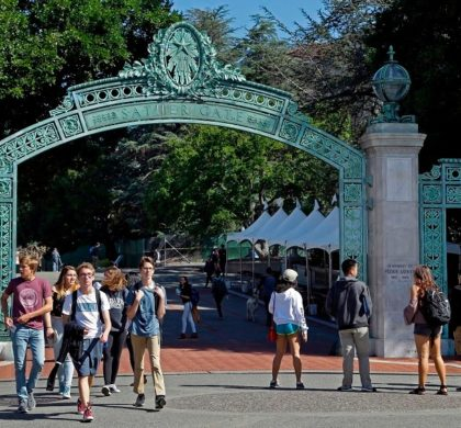 FILE - In this April 21, 2017, file photo, students walk past Sather Gate on the University of California, Berkeley campus in Berkeley, Calif. Students are continuing to apply to the University of California system in record numbers for the 13th straight year. Preliminary data released by the UC system Thursday, Dec. 14, 2017, shows nearly 222,000 prospective undergraduates applied for at least one UC school for the fall of 2018 during the application period that ended Nov. 30. (AP Photo/Ben Margot, File)
