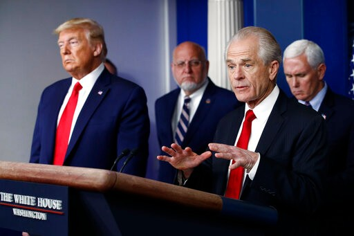 President Donald Trump looks on as White House Senior Policy Advisor Peter Navaro speaks during a coronavirus task force briefing at the White House, Sunday, March 22, 2020, in Washington. (AP Photo/Patrick Semansky)