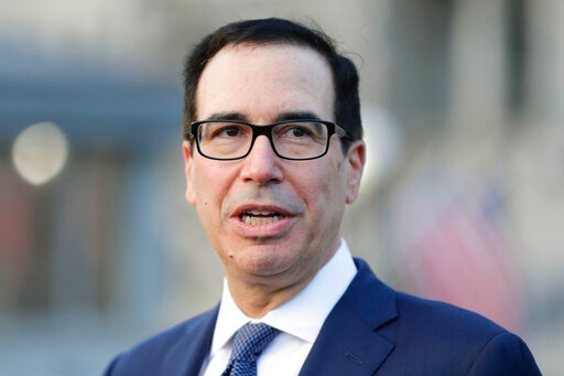 Treasury Secretary Steve Mnuchin speaking to members of the media outside the West Wing of the the White House in Washington, Wednesday, Jan. 15, 2020. (AP Photo/Pablo Martinez Monsivais)