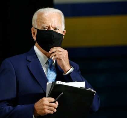 Democratic presidential candidate, former Vice President Joe Biden puts on a face mask to protect against the spread of the new coronavirus as he departs after speaking at Alexis Dupont High School in Wilmington, Del., Tuesday, June 30, 2020. (AP Photo/Patrick Semansky)