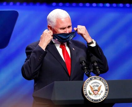 Vice President Mike Pence removes his mask to make comments at First Baptist Church Dallas during a Celebrate Freedom Rally in Dallas, Sunday, June 28, 2020. (AP Photo/Tony Gutierrez)