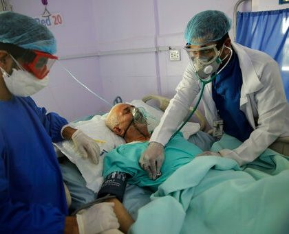 FILE - In this Sunday, June 14, 2020 file photo, medical workers attend to a COVID-19 patient in an intensive care unit at a hospital in Sanaa, Yemen. Researchers in England say they have the first evidence that a drug can improve survival from COVID-19. The drug is a cheap, widely available steroid called dexamethasone. Results released Tuesday, June 16 show it reduced deaths by up to one third in severely ill hospitalized patients. (AP Photo/Hani Mohammed, File)