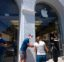 The Apple store is open for the first day since the start of the shutdown during the coronavirus pandemic, Wednesday, June 17, 2020, in Greenwich, Conn. The state began Phase 2 of reopening Wednesday. (AP Photo/Mark Lennihan)