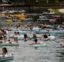 """Tubers float the Comal River despite the recent spike in COVID-19 cases, Thursday, June 25, 2020, in New Braunfels, Texas. Texas Gov. Greg Abbott said Wednesday that the state is facing a """"massive outbreak"""" in the coronavirus pandemic and that some new local restrictions may be needed to protect hospital space for new patients. (AP Photo/Eric Gay)"""