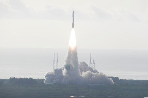 An Atlas V rockets lifts off from the Kennedy Space Center with NASA's Perseverance rover on its way to Mars, Thursday, July 30, 2020, at Cape Canaveral, Fla. The biggest, most sophisticated Mars rover ever built, a car-size vehicle bristling with cameras, microphones, drills and lasers is part part of an ambitious, long-range project to bring the first Martian rock samples back to Earth to be analyzed for evidence of ancient life. (AP Photo/John Raoux)