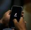 "A man opens social media app 'Tik Tok' on his cell phone, in Islamabad, Pakistan, Tuesday, July 21, 2020. Pakistan has threatened the China-linked TikTok video service and blocked the Singapore-based Bigo Live streaming platform, citing what the regulating authority called widespread complaints about ""immoral, obscene and vulgar"" content. (AP Photo/Anjum Naveed)"