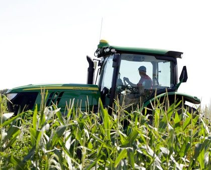 Farmer Tim Novotny of Wahoo, shreds male corn plants in a field of seed corn, in Wahoo, Neb., Tuesday, July 24, 2018. The Trump administration announced Tuesday it will provide $12 billion in emergency relief to ease the pain of American farmers slammed by President Donald Trump's escalating trade disputes with China and other countries. (AP Photo/Nati Harnik)