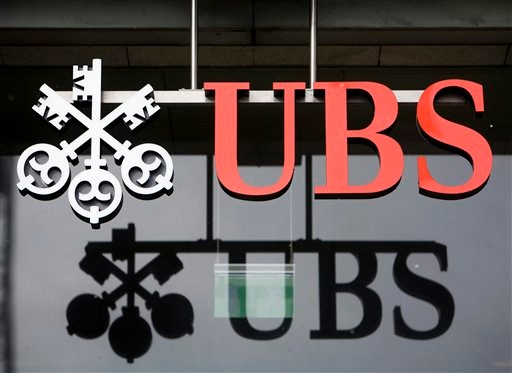 FILE - In this Feb. 12, 2009 file photo, the logo of the Swiss bank UBS, is seen in Aarau, Switzerland. The U.S. government and Swiss banking giant UBS AG have reached a long-awaited agreement in a case over secret Swiss bank accounts for alleged American tax evaders, lawyers for both sides told a federal judge Wednesday, Aug. 12, 2009. (AP Photo/Keystone, Alessandro Della Bella, File)