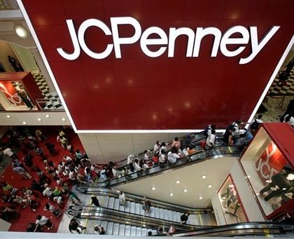 FILE - In this July 31, 2009 file photo, customers are seen in the main entrance of the new JCPenney store in the Manhattan Mall during the grand opening in New York. J.C. Penney Co. said Friday, May 14, 2010, its first-quarter net income more than doubled as sales improved across most categories. (AP Photo/Mary Altaffer, file)