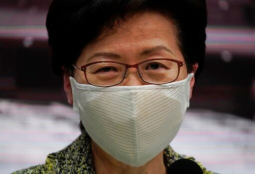 Hong Kong Chief Executive Carrie Lam listens to questions from reporters during a press conference in Hong Kong, Friday, Aug. 7, 2020. The semi-autonomous city of Hong Kong reports 95 new cases and three additional fatalities reported. The city of 7.5 million people has restricted indoor dining and require faces masks to be worn in all public places. (AP Photo/Vincent Yu)