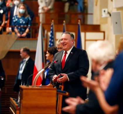 U.S. Secretary of State Mike Pompeo, center, smiles as he arrives for a meeting of the senate in Prague, Czech Republic, Wednesday, Aug. 12, 2020. U.S. Secretary of State Mike Pompeo is in Czech Republic at the start of a four-nation tour of Europe. Slovenia, Austria and Poland are the other stations of the trip. (AP Photo/Petr David Josek, Pool)