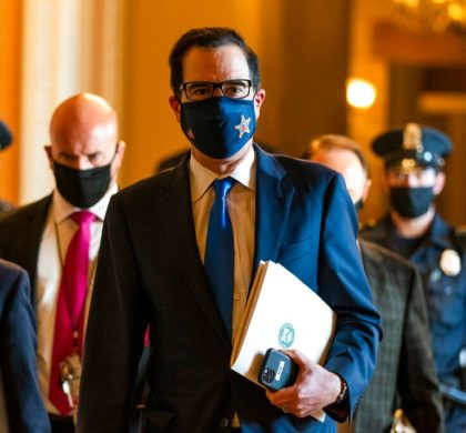 Treasury Secretary Steven Mnuchin, walks from the office of Senate Majority Leader Sen. Mitch McConnell of Ky., as he leaves the Capitol, Wednesday, Sept. 30, 2020, in Washington. Mnuchin earlier met with House Speaker Nancy Pelosi of Calif. (AP Photo/Manuel Balce Ceneta)
