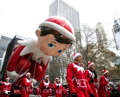 The Elf on the Shelf balloon makes its way down New York's Sixth Avenue during the Macy's Thanksgiving Day Parade, Thursday, Nov. 28, 2019, in New York. (AP Photo/Jeenah Moon)