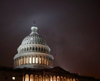 FILE - In this Dec. 9, 2019, file photo mist rolls over the U.S. Capitol dome on Capitol Hill in Washington. On Wednesday, Dec. 11, the Treasury Department releases federal budget data for November. (AP Photo/Patrick Semansky, File)