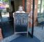 Mary Spoto, general manager of Madison Chop House Grille, places a sign outside the restaurant as she and her staff prepare to shift from take out only to dine-in service Monday, April 27, 2020, in Madison, Ga. Some Georgia restaurants were reopening for limited dine-in service as more restrictions against the coronavirus are loosened in the state. Movie theaters on Monday can welcome customers and limited in-restaurant dining may resume. (AP Photo/John Bazemore)