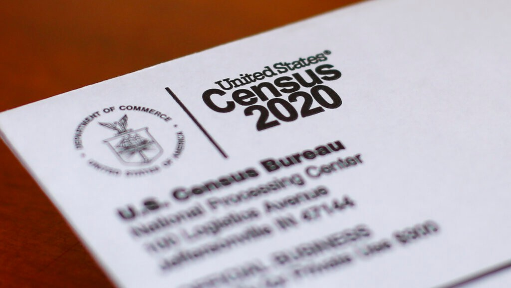 FILE - This Sunday, April 5, 2020, photo shows an envelope containing a 2020 census letter mailed to a U.S. resident in Detroit.  The U.S. Census Bureau has spent much of the past year defending itself against allegations that its duties have been overtaken by politics. With a failed attempt by the Trump administration to add a citizenship question, the hiring of three political appointees with limited experience to top positions, a sped-up schedule and a directive from President Donald Trump to exclude undocumented residents from the process of redrawing congressional districts, the 2020 census has descended into a high-stakes partisan battle.  (AP Photo/Paul Sancya, File)