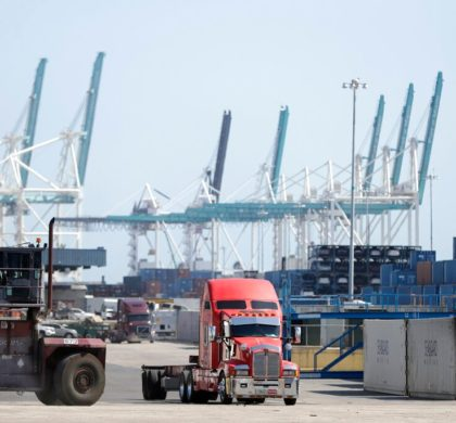 FILE - In this Feb. 14, 2020 file photo,  a truck leaves the docks at PortMiami in Miami.  The U.S. economy shrank at an alarming annual rate of 31.7% during the April-June quarter as it struggled under the weight of the viral pandemic, the government estimated Thursday, Aug. 27.  (AP Photo/Wilfredo Lee, File)