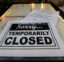 A closed sign is posted at a restaurant along the River Walk in San Antonio, Tuesday, April 28, 2020. Texas Gov. Greg Abbott is allowing Texas' stay-at-home orders to expire this week and easing restrictions on non-essential business and restaurants can open for seating with 25 percent capacity. (AP Photo/Eric Gay)