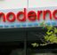 A sign marks an entrance to a Moderna, Inc., building, Monday, May 18, 2020, in Cambridge, Mass. Moderna announced Monday, May 18, 2020, that an experimental vaccine against the coronavirus showed encouraging results in very early testing, triggering hoped-for immune responses in eight healthy, middle-aged volunteers.(AP Photo/Bill Sikes)