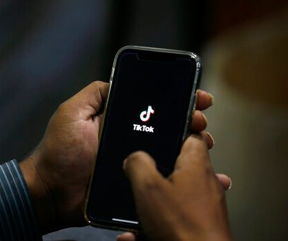 """A man opens social media app 'Tik Tok' on his cell phone, in Islamabad, Pakistan, Tuesday, July 21, 2020. Pakistan has threatened the China-linked TikTok video service and blocked the Singapore-based Bigo Live streaming platform, citing what the regulating authority called widespread complaints about """"immoral, obscene and vulgar"""" content. (AP Photo/Anjum Naveed)"""