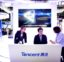 In this April 27, 2017, photo, staff members work at a booth for Chinese technology firm Tencent, makers of the messaging app WeChat, at the Global Mobile Internet Conference (GMIC) in Beijing. President Donald Trump on Thursday, Aug. 6, 2020, ordered a sweeping but unspecified ban on dealings with the Chinese owners of consumer apps TikTok and WeChat, although it remains unclear if he has the legal authority to actually ban the apps from the U.S. (AP Photo/Mark Schiefelbein)