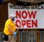 A worker passes a sign at a restaurant along the River Walk that has reopened in San Antonio, Wednesday, May 13, 2020. Many restaurants and stores that were closed due to the COVID-19 pandemic have reopened with some restrictions. (AP Photo/Eric Gay)