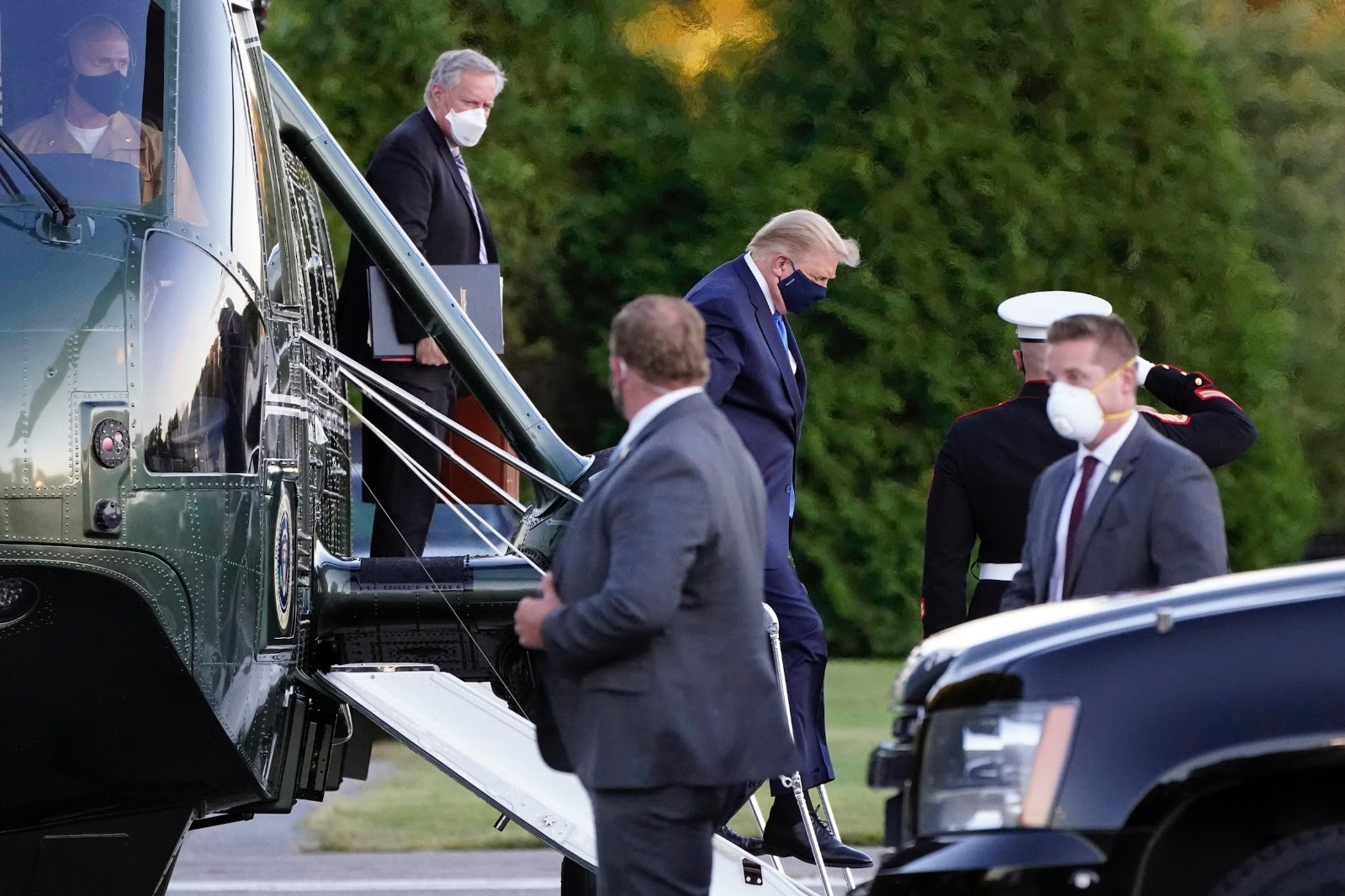 President Donald Trump arrives at Walter Reed National Military Medical Center, in Bethesda, Md., Friday, Oct. 2, 2020, on Marine One helicopter after he tested positive for COVID-19. White House chief of staff Mark Meadows is at left. (AP Photo/Jacquelyn Martin)