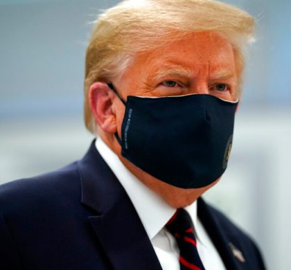 In this July 27, 2020, file photo, President Donald Trump wears a face mask as he participates in a tour of Bioprocess Innovation Center at Fujifilm Diosynth Biotechnologies in Morrisville, N.C. President Donald Trump and first lady Melania Trump have tested positive for the coronavirus, the president tweeted early Friday. (AP Photo/Evan Vucci, File)