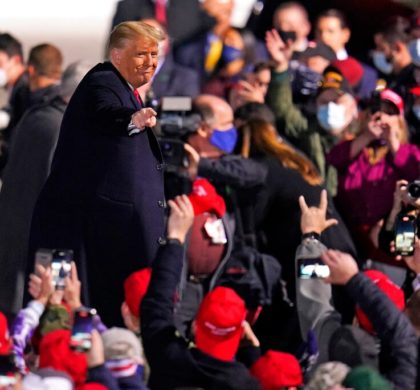 Supporters cheer as President Donald Trump departs following a campaign rally at Erie International Airport, Tom Ridge Field in Erie, Pa, Tuesday, Oct. 20, 2020. (AP Photo/Gene J. Puskar)